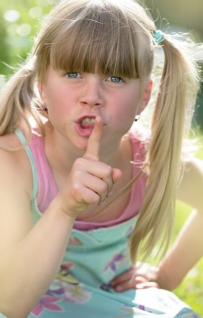 girl saying to be quiet